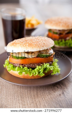 Hamburger with potato chips and a drink - stock photo