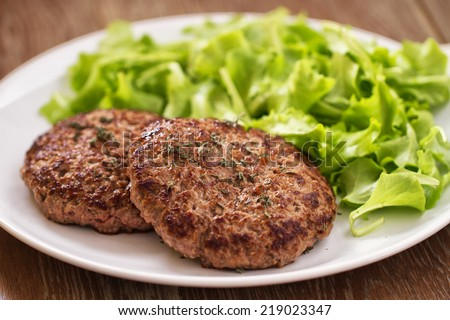 Hamburger with salad - stock photo