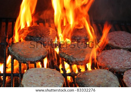 Hamburgers on a grill - stock photo