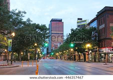 HAMILTON, ONTARIO - JULY 1, 2016: Lights and trees of King Street East. This Canadian port city is on the western tip of Lake Ontario and is the centre of a densely populated and industrialized region - stock photo