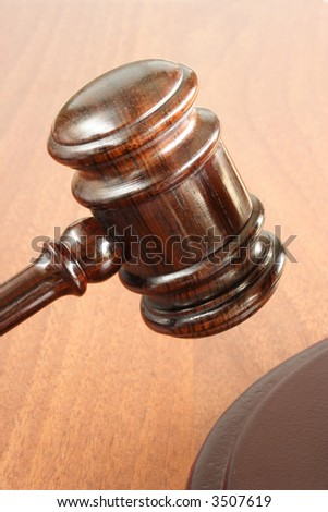 Hammer and gavel in the courthouse - stock photo