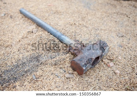 Hammer hitting the floor - stock photo
