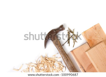 Hammer, nails and boards on a white background - stock photo