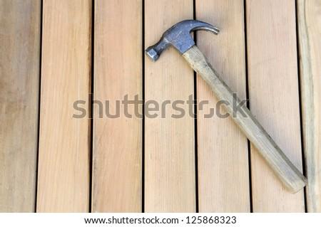 Hammer on New Wood - stock photo