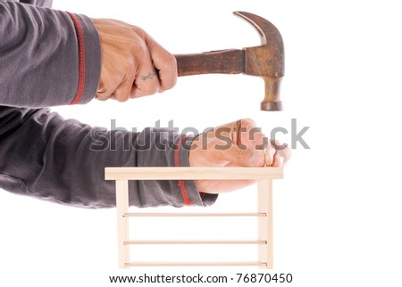 Hammering The Final Pieces Together - stock photo
