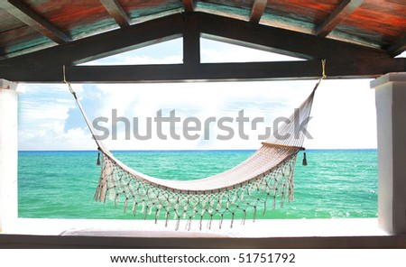 Hammock in front of Tropical ocean. - stock photo
