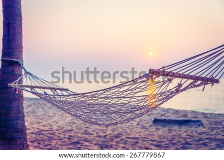 Hammock sunset on the beach - vintage filter - stock photo