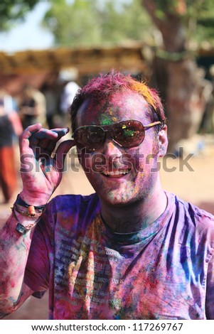HAMPI - MARCH 9: Unidentified man celebrates Holi festival in Hampi, India on March 9, 2012. It's a religious spring holiday and also known as Festival of Colours. - stock photo