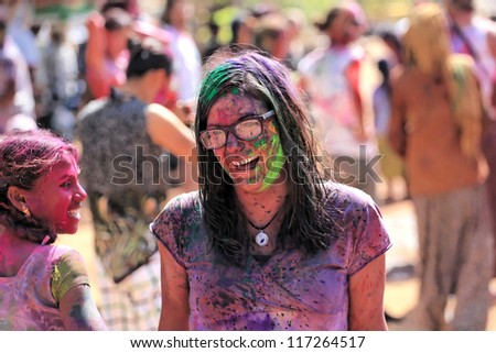 HAMPI - MARCH 9: Unidentified woman celebrates Holi festival in Hampi, India on March 9, 2012. It's a religious spring holiday and also known as Festival of Colours. - stock photo