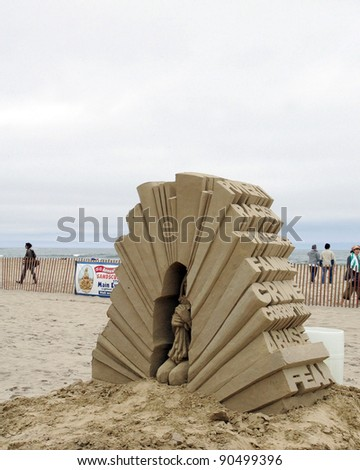 "HAMPTON BEACH, NH, USA - JUNE 28: ""Lamb"" by Carl Jara on display at the Master Sand Sculpting Competition on June 28, 2011 in Hampton Beach, NH, USA - stock photo"
