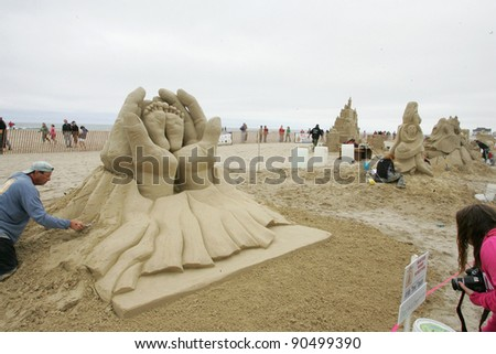 "HAMPTON BEACH, NH, USA - JUNE 28: ""Precious"" by Steve Topazio on display at the Master Sand Sculpting Competition on June 28, 2011 in Hampton Beach, NH, USA - stock photo"