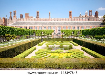 HAMPTON COURT PALACE, ENGLAND - APRIL 23: View of the Historic Royal Palace of Hampton Court and gardens on April 23, 2011. The famous Hampton Court Flower Show is held here in July every year. - stock photo