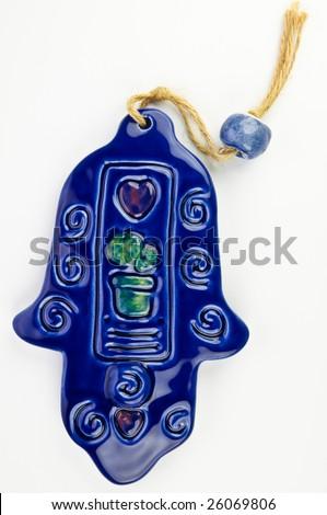 Hamsa hand amulet, used to ward off the evil eye - ceramic wall decoration - stock photo