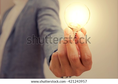 hand action icon symbol on business suit means business actions or activities use for empower, encourage, work, win, fight, victory business, or present work, business, products with light bulb - stock photo
