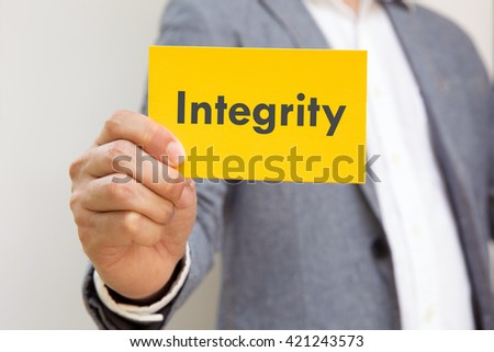 """hand action on business suit means business activities use for empower,encourage,work business, or present work, business, products, recruit with yellow card word """"integrity"""" - stock photo"""