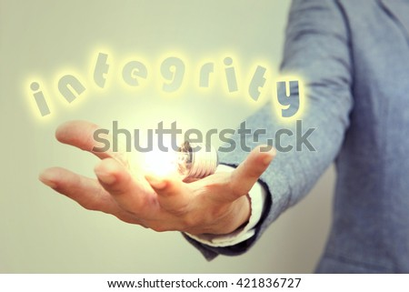 """hand action symbol on business suit means business actions or activities use for empower,encourage,work,business, or present work,business,products with light bulb and word """" integrity """" - stock photo"""
