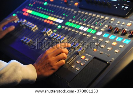 Hand adjusting sound mixer - stock photo
