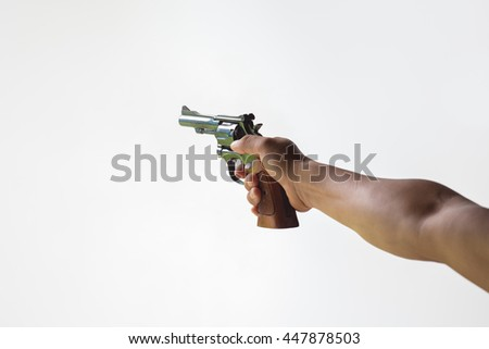 hand aim revolver gun isolated on white background - stock photo