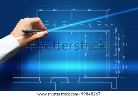Hand and blueprint - engineer working on blue print concept - stock photo