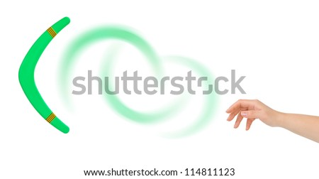 Hand and boomerang isolated on white background - stock photo