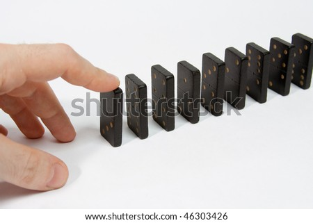 Hand and domino isolated on white background - stock photo