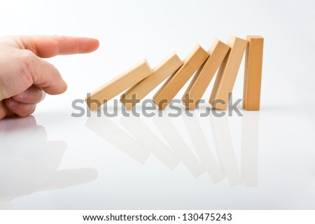 Hand and falling pieces on white background - stock photo