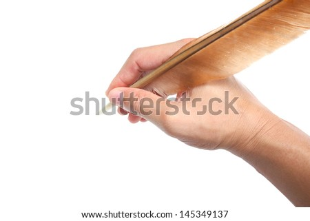 hand and feather pen over white background - stock photo