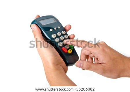 Hand and fingers entering pin with a hand held pin pad. - stock photo