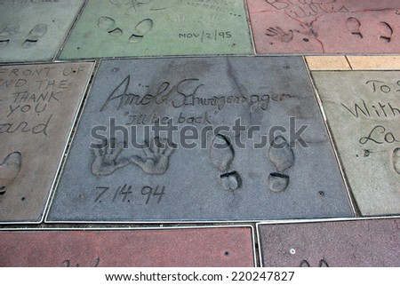 Hand and Foot Prints of Movie Stars on the Hollywood Walk of Fame on Hollywood Boulevard in Los Angeles, California on May 19, 2014 - stock photo