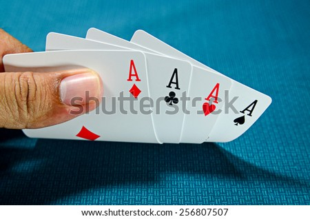 Hand and four aces , playing cards - stock photo