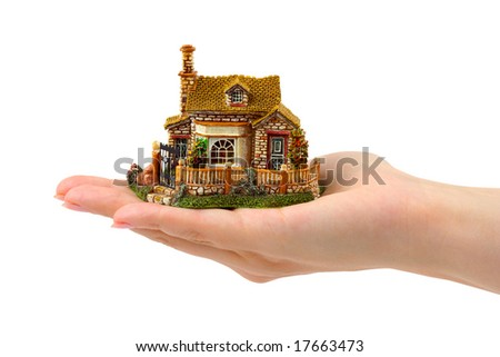 Hand and house isolated on white background - stock photo