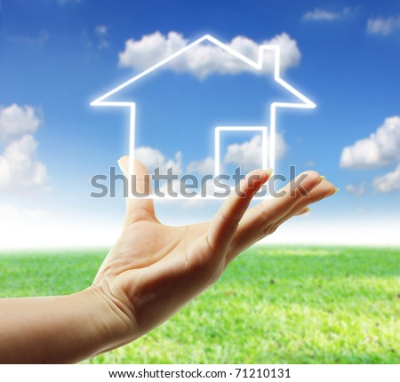 hand and icon house - stock photo