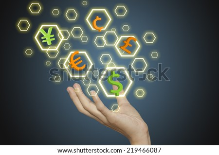 Hand and Investment concept with currency symbols. - stock photo