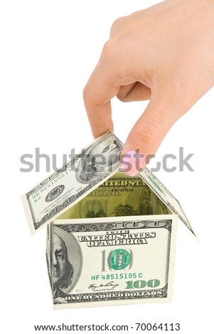 Hand and money house isolated on white background - stock photo