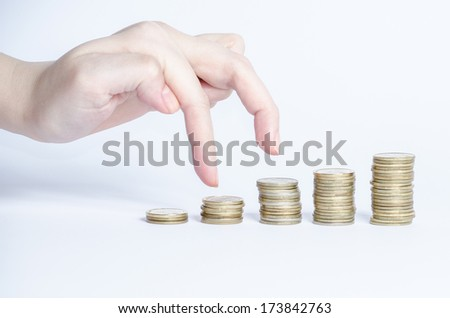 Hand and money staircase - stock photo