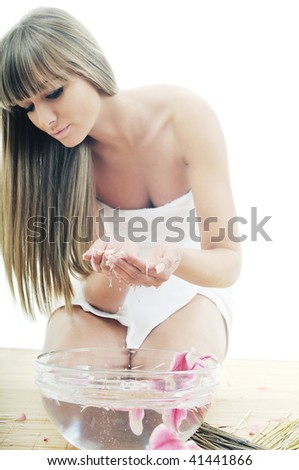 hand  and nail spa and beauty treatment with aroma and flowers in water isolated on white - stock photo