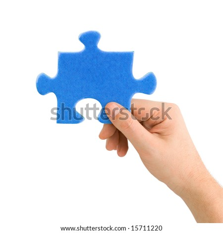 Hand and puzzle isolated on white background - stock photo