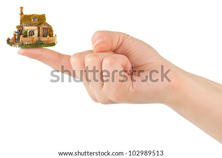 Hand and small house isolated on white background - stock photo