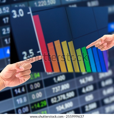 Hand and stock graph,Stock market chart,Stock market data on LED display concept - stock photo