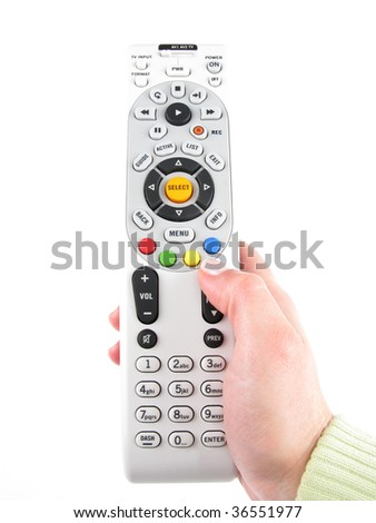 Hand and tv remote control over white - stock photo