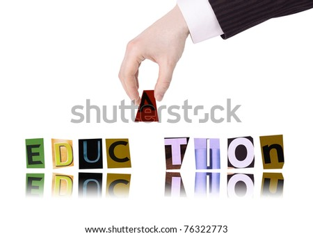 Hand and word education isolated on white background - stock photo