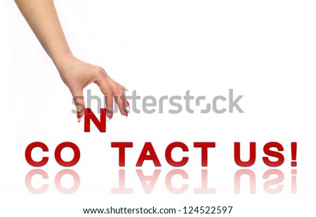 Hand and words Contact Us - stock photo