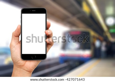 Hand are holding Smartphone with sky train background - stock photo
