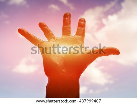 Hand asking help against sky - stock photo