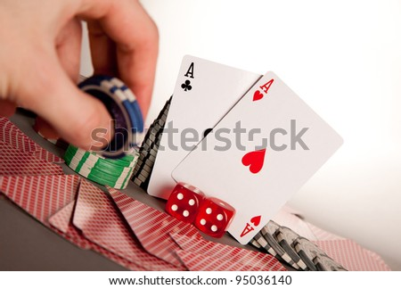 hand betting with winning hand a pair of aces - stock photo