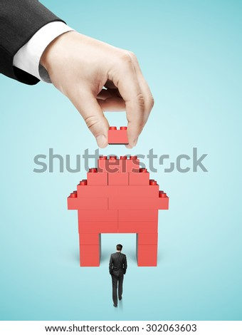 hand build house blocks on blue background - stock photo