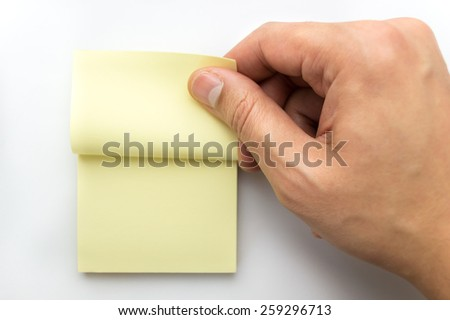 hand catching a note from post it - stock photo