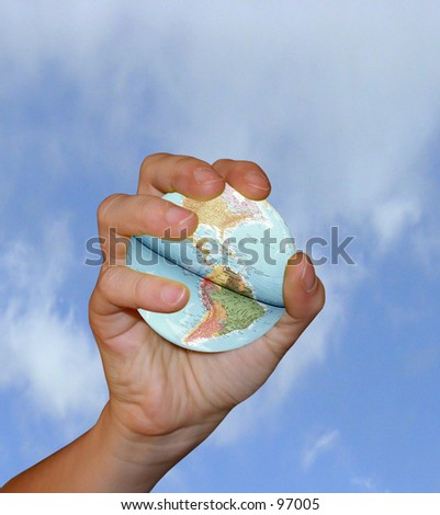 Hand catching an earth globe - stock photo