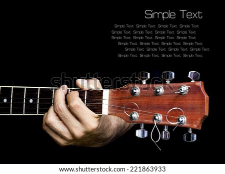 Hand catching guitar.Provide an example for the guitar chords.Finger press down on frets. Isolate background.with text area. - stock photo