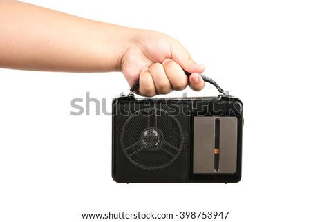 hand children hold old AM FM radio isolated on white background - stock photo
